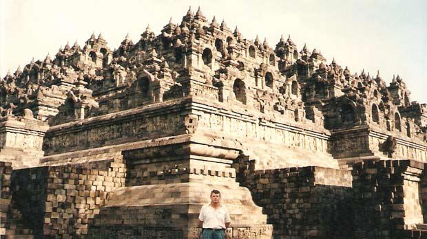 Dwarfed by Borobudur in Java, Indonesia.