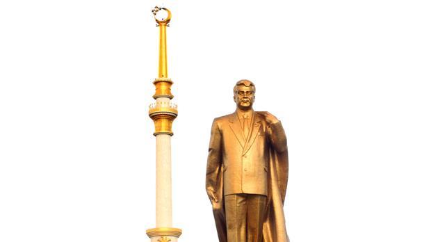 Mammoth solid gold statue of ex-President Niyazov.