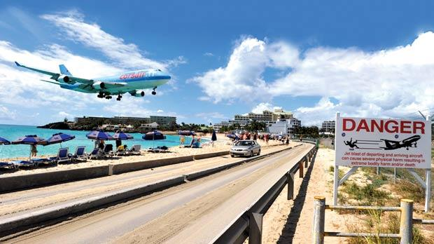 As planes approach St Maarten's Princess Juliana Airport, their wheels whizz just over the heads of the people lounging on one of the island's busiest beaches.