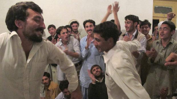 Men dance at the 'special cultural show'. Photos: Stephen Bailey