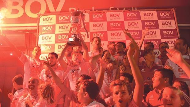 Red is the colour... Neptunes players celebrate their league triumph. INSET: Zoran Maslovar, the Neptunes coach. Photos: Mark ZammitCordina
