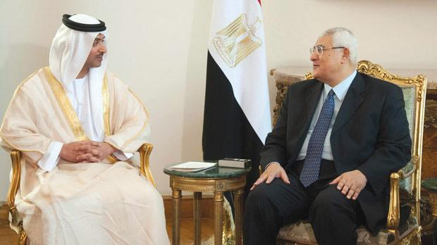 Egypt's interim President Adli Mansour (right) meeting with UAE's National Security Adviser Sheikh Hazza bin Zayed Al Nahyan at El-Thadiya presidential palace in Cairo yesterday. Photo: Reuters