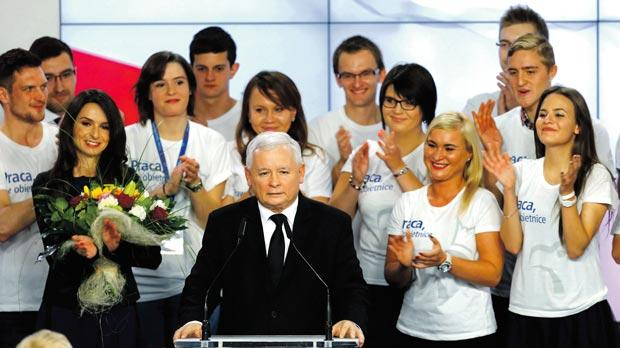 The leader of Poland's main opposition party Law and Justice (PiS) Jaroslaw Kaczynski prepares to address the public as his daughter Marta (left) looks on after the exit poll results were announced in Warsaw, Poland yesterday. Photo: Reuters