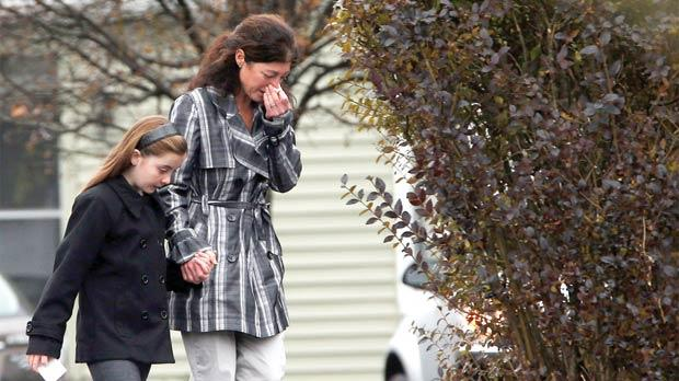 Tearful mourners leaving the Honan Funeral Home, where the family of six-year-old Jack Pinto was holding his funeral service, in Newtown, Connecticut, yesterday. Photos: Reuters