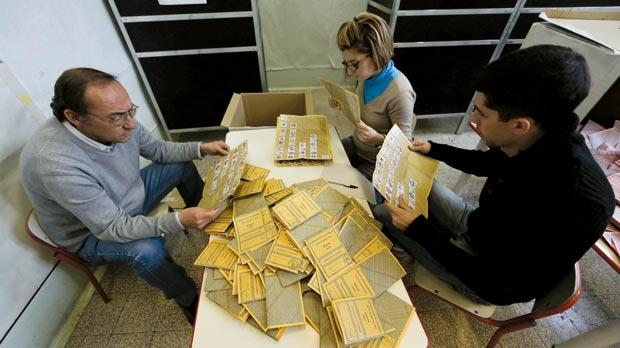 Voting officials count the ballots in a polling station in Rome yesterday. Photo: Reuters
