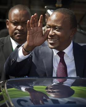Kenya's President-elect Uhuru Kenyatta gestures to supporters as he leaves the National Election Centre where final election results were announced declaring he would be the country's next President, in Nairobi, Kenya, yesterday. Photos: PA