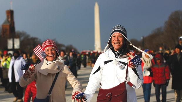 People smile as they enter the National Mall for the ceremonial swearing-in on the West front of the US Capitol in Washington. Photo: Shannon Stapleton/Reuters