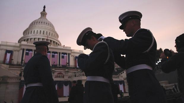 Members of the military prepare at sunrise before the presidential inauguration on the West Front of the US Capitol. Photo: Win McNamee/Reuters