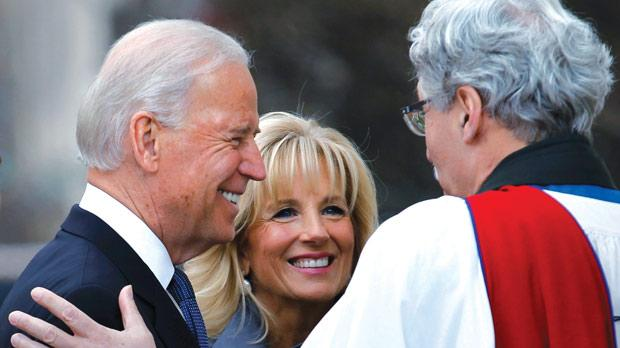 US Vice President Joe Biden and his wife, Dr Jill Biden, talk with Reverend Luis Leon outside St John's Church prior to inauguration ceremonies in Washington. Photo: Joe Skipper/Reuters