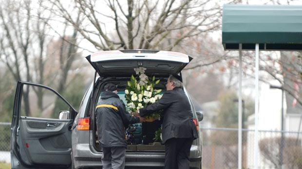 A florist delivering funeral bouquets for Noah Pozner's funeral yesterday at the Abraham L. Green and Son Funeral Home in Fairfield, Connecticut. Photo: AFP