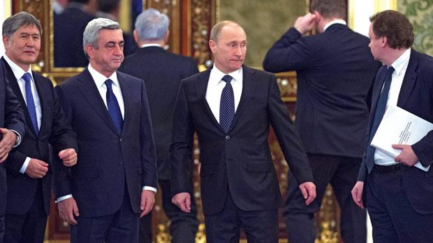 Russian President Vladimir Putin, centre, before an expanded meeting of the CSTO Collective Security Council at the Moscow Kremlin, yesterday. From left: Kyrgyz President Almazbek Atambayev and Armenian President Serzh Sargsyan. Photo: AFP