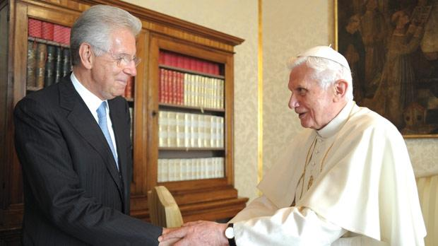 Pope Benedict XVI greeting Italy's Prime Minister Mario Monti during a private audience at the Pontiff's summer residence in Castelgandolfo in August. Photo: AFP