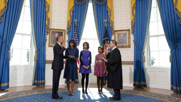 President Barack Obama was officially sworn in by Chief Justice John Roberts in the Blue Room of the White House during the 57th Presidential Inauguration in Washington, yesterday. Next to Obama are first lady Michelle Obama, holding the Robinson Family Bible, and daughters Malia and Sasha. Photo: AP