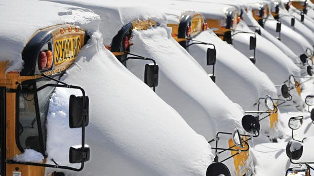 School buses covered in snow after a winter storm in Hartford, Connecticut, yesterday. Photo: PA