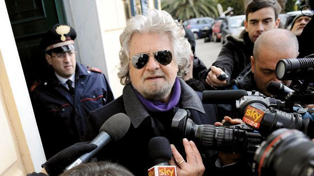 Five Star Movement leader and comedian Beppe Grillo speaking with media after casting his vote at the polling station in Genoa yesterday. The projected result of the outcome in Italy's election was a stunning success for the Genoese comic, who toured the country in his first national election campaign hurling obscenity-laced insults against a discredited political class.