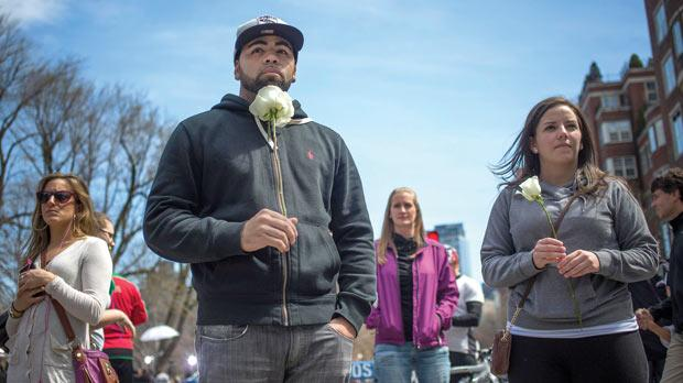 Mourners hold flowers outside the barricaded entrance at Boylston Street near the finish line of the Boston Marathon yesterday. Photo: Reuters