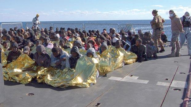 Migrants on a Marina Militare vessel during a rescue operation by Italian navy off the coast of Sicily. Photo: Reuters