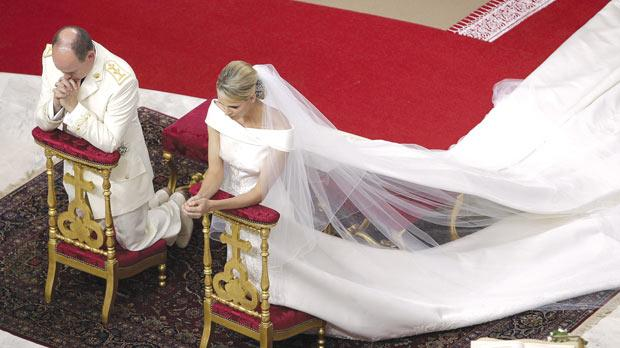 Prince Albert II of Monaco and Charlene Princess of Monaco kneel in prayer during their religious wedding ceremony at the Monaco palace, yesterday. Photo: PA
