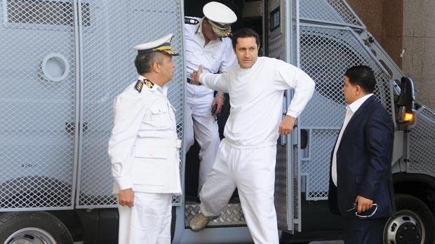 Corruption charges against Mubarak's sons Alaa (centre) and Gamal were dropped due to the expiry of a statute of limitations.