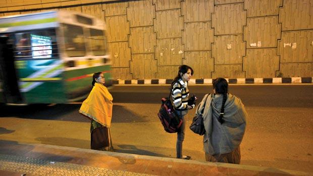 Commuters wait to get on a bus at the stop where police say a 23-year-old woman boarded and was subsequently raped by six people while the vehicle was moving on December 16, 2012, in New Delhi. Photo: Reuters