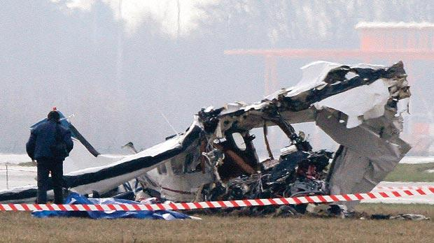 A police photographer inspects the scene of a tourist plane crash at Charleroi airport yesterday. Photo: Reuters