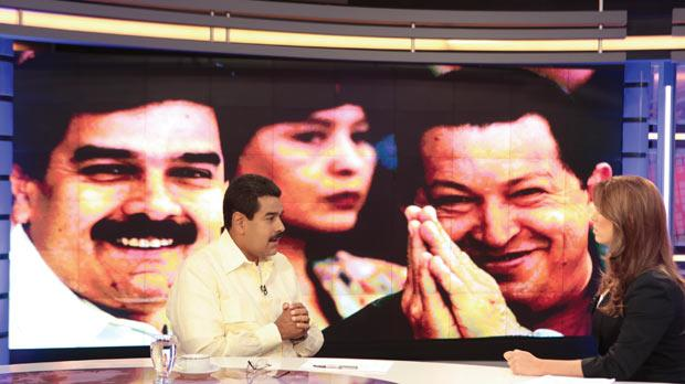 Acting Venezuelan President Nicolas Maduro, left, speaks during an interview with the news station Telesur in Caracas. Photo: Reuters