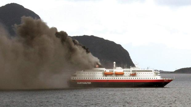 Smoke billowing out from Norwegian fjord cruise ship Nordlys (Northern Light) at Aalesund in western Norway, yesterday. Photo: Svein Ove Ekornesvag/AFP