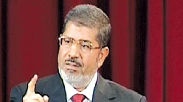 An image grab from Egypt's Nile TV shows Egyptian President Mohamed Morsi giving his first official presidential address at Cairo University yesterday after taking the oath of office. Photo: AFP