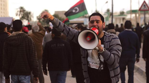 A Libyan protester shouts slogans with a megaphone during a demonstration in Benghazi yesterday. Photo: AFP