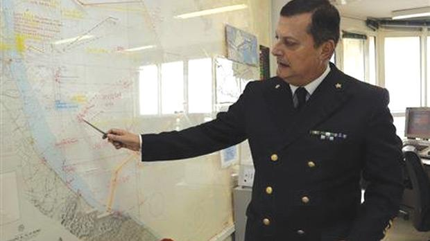 Admiral Francesco Saverio Ferrara Of Italy Points At A Map Which Shows The Coordinates To Search