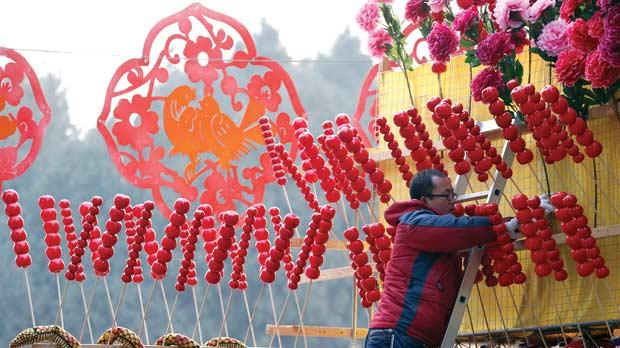 A snake-shaped doll is displayed at a shop during the temple fair in Ditan Park, also known as the Temple of Earth, in Beijing yesterday. The Lunar New Year, or Spring Festival, begins on February 10 and marks the start of the Year of the Snake, according to the Chinese zodiac. Photo: Reuters