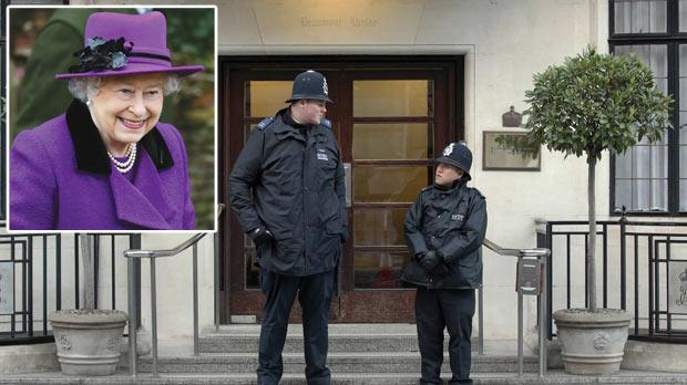 Police outside King Edward VII's Hospital, central London, as Queen Elizabeth II is recovering after being admitted with symptoms of gastroenteritis, yesterday. Inset: Queen Elizabeth II. Photos: AP