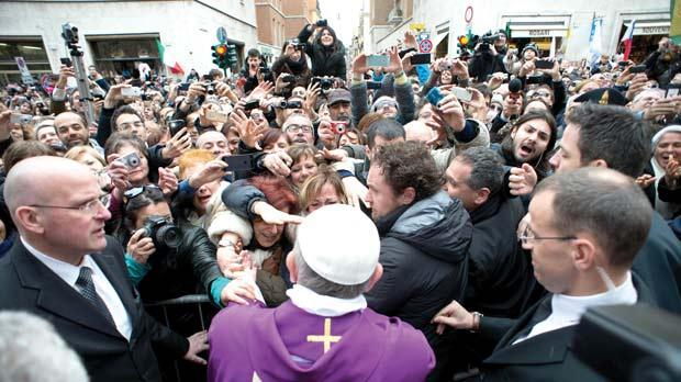 Pope Francis greets faithful from a side gate of the Vatican yesterday. Photo: AP/L'Osservatore Romano