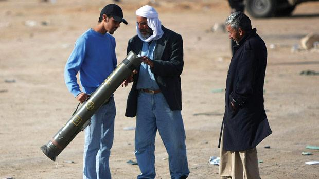 Libyan rebels check a French-made anti-tank Milan rocket launcher tube at the western gate of the strategic town of Ajdabiya yesterday. Photo: Marwan Naamani/AFP