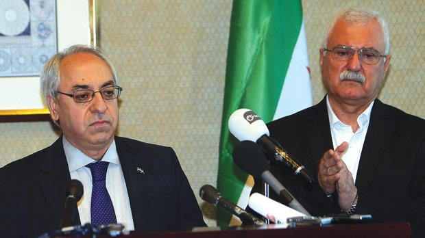 Syrian National Council (SNC) outgoing chief Abdel Basset Sayda (left) stands with the newly elected chief George Sabra during a joint news conference on the sidelines of the SNC General Assembly in Doha. Photo: AFP