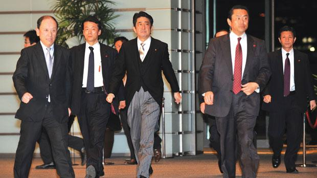 Shinzo Abe (centre), leader of the Liberal Democratic Party, taking office as Japan's new Prime Minister on his arrival after the attestation ceremony in the Imperial Palace in Tokyo yesterday. Photo: AFP