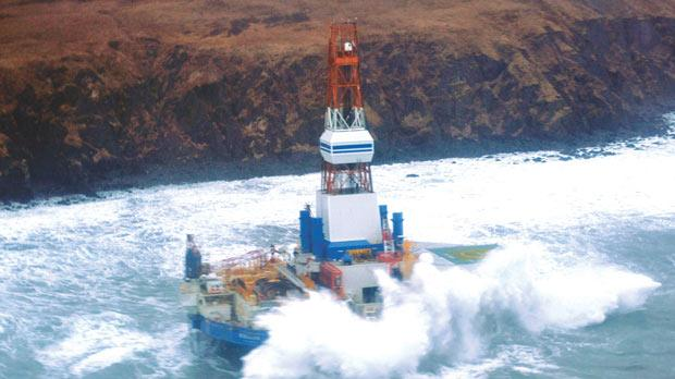 Waves crash over the conical drilling unit Kulluk where it sits aground on the southeast side of Sitkalidak Island, Alaska, US. Photo: Reuters