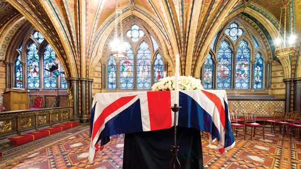 The coffin of Baroness Thatcher rests in the crypt chapel of St Mary Undercroft, beneath the Houses of Parliament in central London, yesterday. Photo: PA