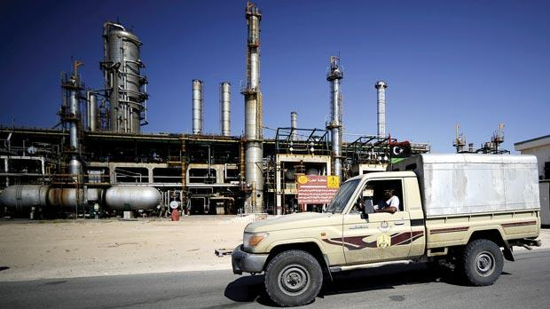 Libyan rebels driving past the Zawiya oil refinery, some 40 kilometres west of Tripoli.