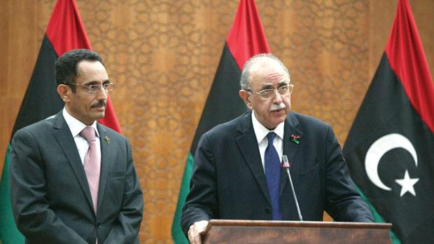 Abdel Hafiz Ghoga (left), vice chairman of the National Transitional Council and spokesman for the new authorities, listening to Libya's interim Prime Minister Abdel Rahim al-Kib as he announced his new Cabinet line-up on Tuesday. Photo: Mahmud Turkia/AFP