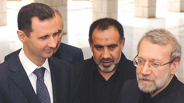 Syrian President Bashar al-Assad (left) speaking to the press with Iranian Parliament Speaker Ali Larijani (right) following their meeting in Damascus, as the latter began a regional tour to find a solution to the conflict in his country's key ally. Photo: AFP