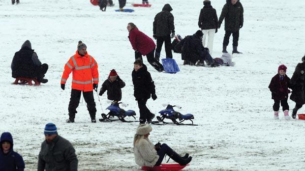 People enjoying the snow on Camp Hill, Woolton, Liverpool, yesterday. Photo: Peter Byrne/PA Wire