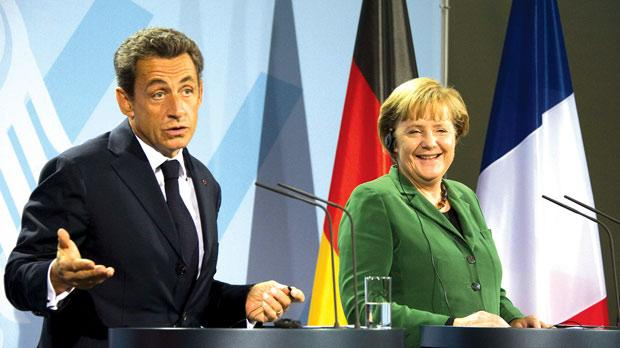 German Chancellor Angela Merkel and French President Nicolas Sarkozy giving a statement yesterday at the Chancellery in Berlin following a key summit on steps to combat debt turbulence in the eurozone. The leaders of Europe's two biggest economies are expected in particular to try to hammer out details of a plan to recapitalise Europe's banks amid fears of a crippling credit crunch. Photo: Odd Andersen/ AFP