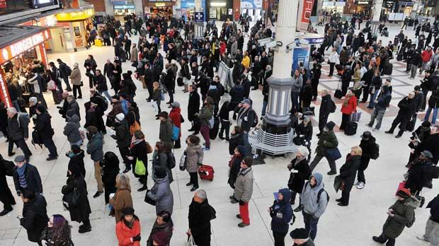 Travellers waiting for their trains at Victoria Station, central London, as snow hit UK travellers nationwide yesterday, with roads shut, trains cancelled or delayed and flights disrupted. Photo: PA