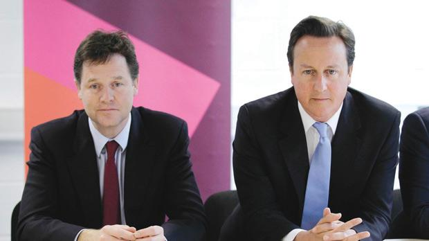 File photo of Prime Minister David Cameron (right) and his deputy Nick Clegg in 2011. Photo: Matt Dunham/PA