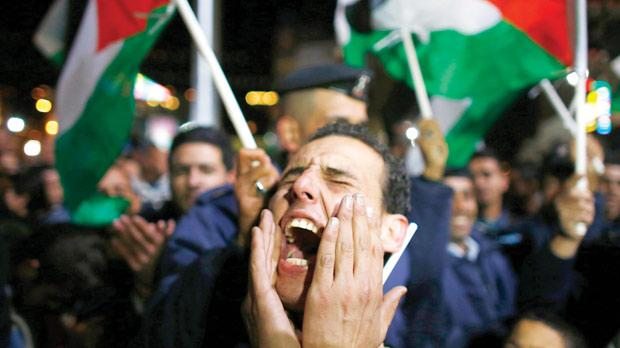 "A Palestinian man shouts slogans during a rally in the West Bank city of Ramallah yesterday, after the 193-nation UN General Assembly overwhelmingly approved a resolution to upgrade the Palestinian Authority's observer status from ""entity"" to ""non-member state"", implicitlyrecognising a Palestinian state. Photo: Reuters/Marko Djurica"