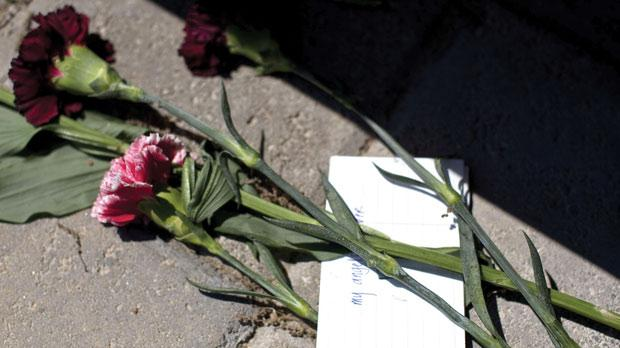 Flowers and a note sitting on the April 16 memorial on the campus of Virginia Tech in Blacksburg, Virginia.