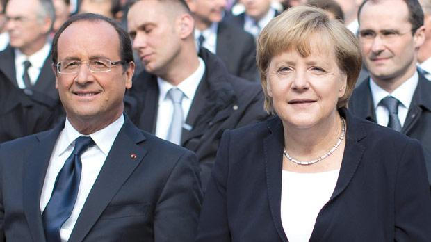 German Chancellor Angela Merkel and French President François Hollande at the 50th anniversary of Charles de Gaulle's speech to German youth in Ludwigsburg, Germany, yesterday. Photo: AFP