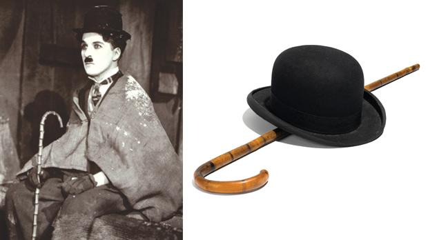 Left: Charlie Chaplin wearing his trademark bowler and cane in his trademark Little Tramp character.
