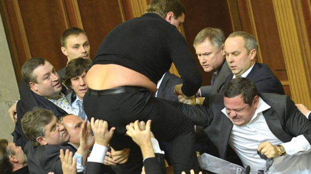 MPs of the opposition fight with MPs of the majority party during the opening of the newly elected Ukrainian Parliament in Kiev. Photo: AFP